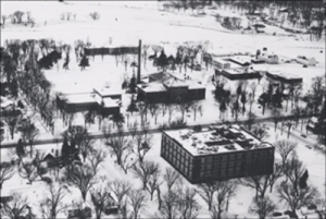Aerial of campus 1955 - barns in back far right